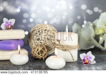 Spa Resort Therapy Composition With Burning Candles, Orchid Flowers, Soap, Rattan Balls And Abstract