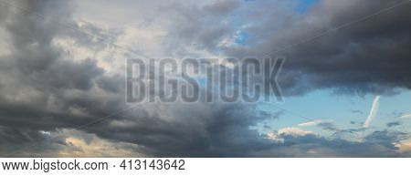 Dramatic Dark Sky With Rays And White Clouds At Sunset