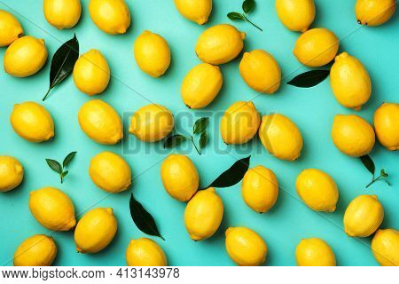 Immune System Booster. Fresh Lemons Pattern On Blue Background. Copy Space. Top View. Flat Lay. Citr