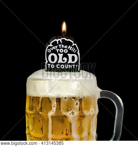 Close Up Of Black Tombstone Candle For Over The Hill Birthday In Beer Mug Isolated On Black