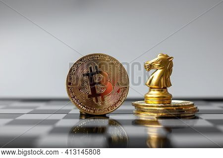 Golden Bitcoin Cryptocurrency Coin Stack And Chess Knight Piece, Crypto Is Digital Money Within The