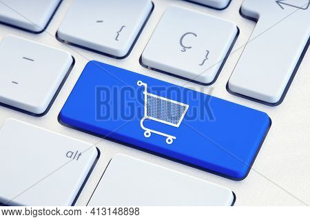 Online Shopping, Ecommerce, Internet Shopping Concept. Shopping Cart Icon On Blue Keyboard Key