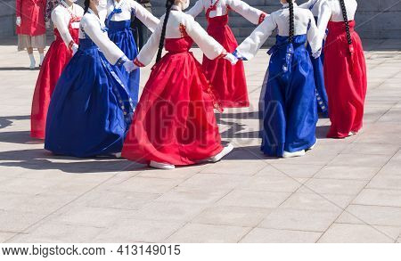 Womans Wearing Hanbok, A Traditional Korean Costume, Are Performing Traditional Korean Circle Dance