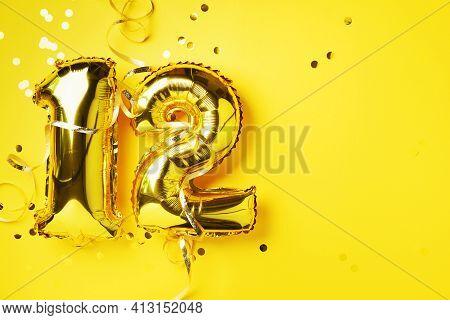 Gold Foil Balloon Number, Digit Twelve. Birthday Greeting Card, Inscription 12. Anniversary Celebrat