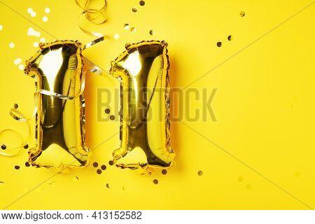 Gold Foil Balloon Number, Digit Eleven. Birthday Greeting Card, Inscription 11. Anniversary Celebrat