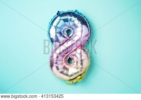 8 March. Happy Women's Day. Creative Layout. Rainbow Foil Balloon Number And Digit Eight 8. Birthday