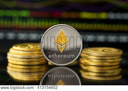 Silver And Gold Ethereum Coin With A Graph Chart. Trading On The Cryptocurrency Exchange. Cryptocurr