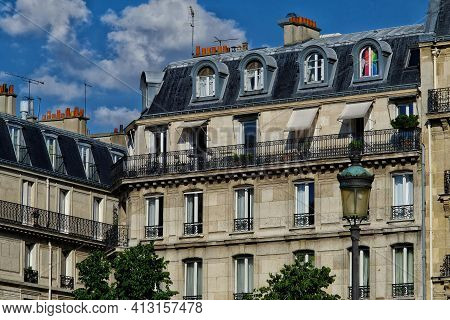 Beautiful Residential Buildings With Balconys And Chimneys In The Centre Of Paris France On A Sunny