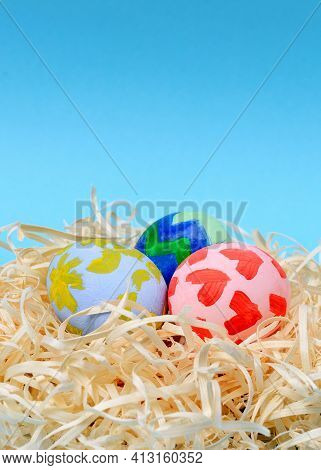 Close-up Of Colorful Easter Eggs With Children Drawings. Handmade Decorated Easter Eggs. Above View.
