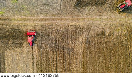 Aerial Top View Of Three Tractors, One Is Dragging A Disc Harrow And Another A Seedbed Cultivator, T