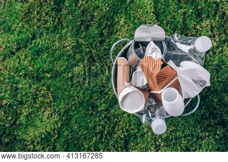 Reuse Garbage, Recycle, Plastic Free. Food Plastic Packaging In Trash Bin On Green Moss Background A