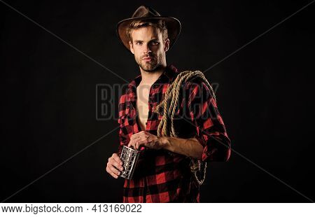 Western Culture. Man Wearing Hat Hold Rope And Flask. Lasso Tool Of American Cowboy. Man Handsome Un