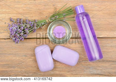 Hygiene And Skin Care Product Samples With Lavender Flowers On Wooden. Soap, Shampoo, Lavender Oil,