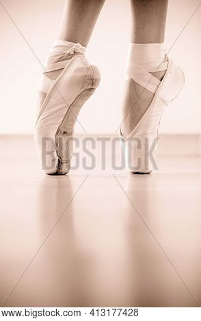 Close-up Of Ballerinas Pointe Shoes. Classical Ballet