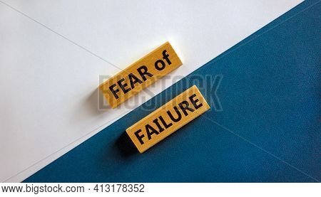 Fear Of Failure Symbol. Wooden Blocks With Words 'fear Of Failure'. Beautiful White And Blue Backgro