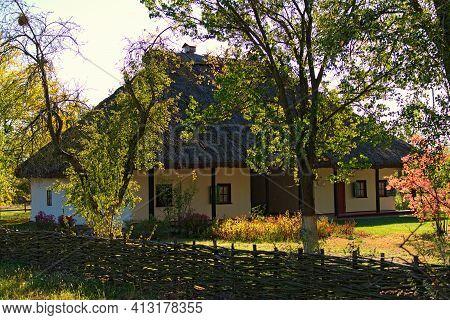 Pereyaslav, Ukraine-october 14, 2020:typical Clay House Called Shunok (tavern Or Bar) And Old Timber