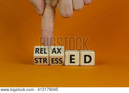 Stressed Or Relaxed Symbol. Businessman Turns Cubes And Changes The Word 'stressed' To 'relaxed'. Be
