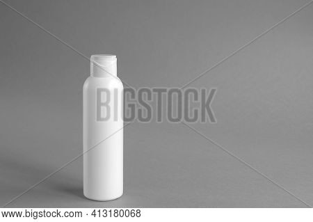 White Plastic Cosmetic Lotion Bottle Mock-up With Cap On Gray Background. Hygiene, Beauty And Body S