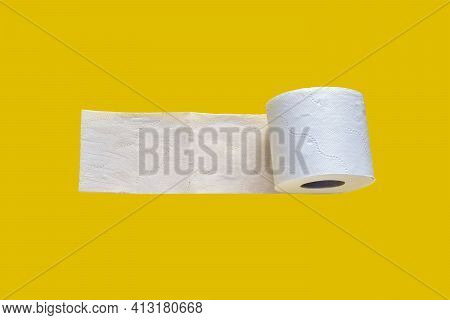 One Roll Of White Toilet Paper Isolated On Yellow Background. Roll Of Soft Layered Toilet Paper, Hyg
