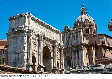Roman Forum, Rome, Italy - May 17, 2017: The Arch Of Septimius Severus (on The Left) And Other Impor