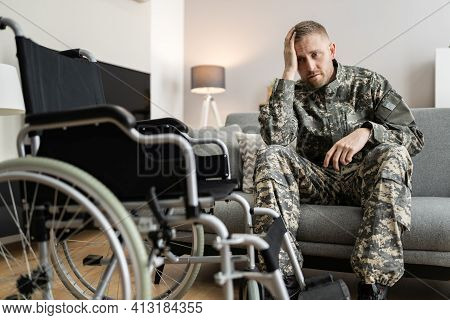 Disabled Military Soldier In Wheelchair With Ptsd After Injury And Trauma