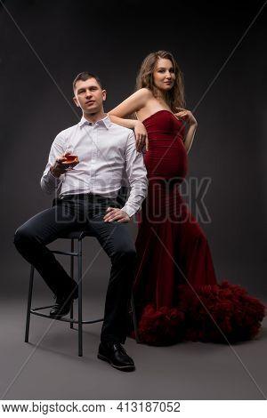 Stylish Couple In Elegant Clothes In Studio