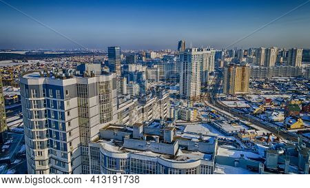 View Of The City From Above. Residential Area In Minsk. Aerial View From Drone In Winter Day. Urban