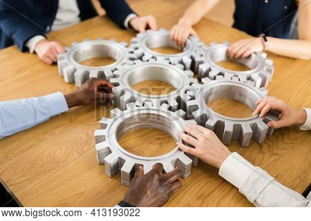 Businesspeople Hands Joining Gears. Support And Implementation