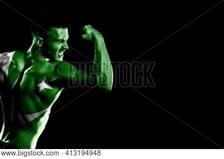 Pakistan Flag On Handsome Young Muscular Man Black Background