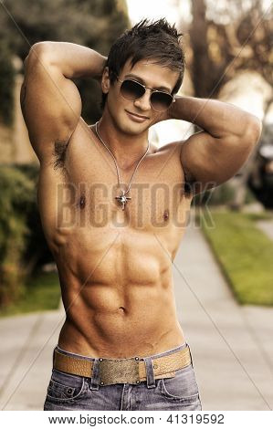 Fashion portrait of a very muscular sexy coll young man