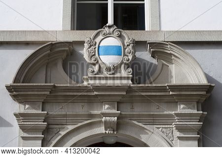 Emblem Of The Canton Zug On A Beautiful Decorated Building Entrance