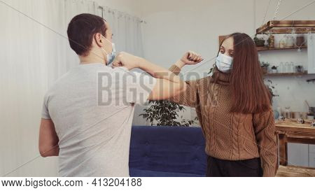 Social Distance. Two Businessmen Touch Elbows. Bump Avoid Greeting. Pandemic Concept. Man And Woman