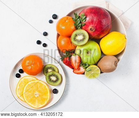 Flatlay Assorted Fresh And Ripe Fruits And Berries On A Plate. The Concept Of Healthy Eating.