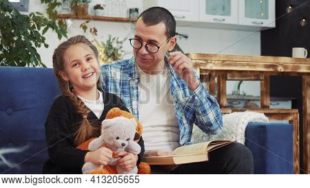 Lockdown Daddy Read A Book To Her Daughter At Home. Kid Dream Coronavirus Stay Home Concept. Daddy I