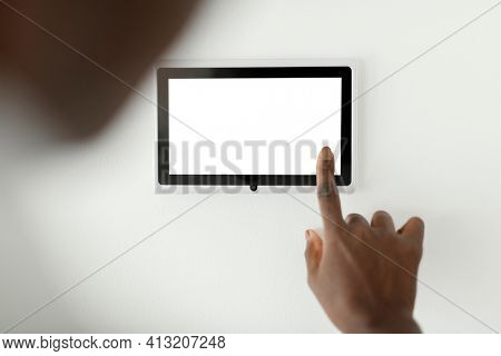 Woman pressing on smart home automation panel monitor