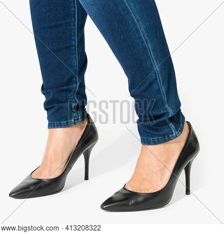 Woman with her black high heel