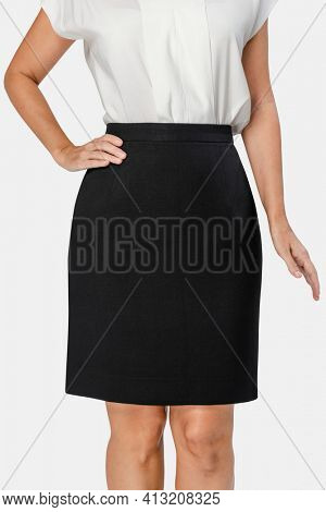 Businesswoman wearing a formal black skirt