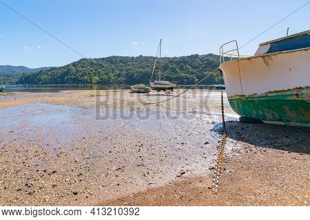Boats Lying On Beach At Low Tide On Shoal Bay In Tryphena Harbour Great Barrier Island.