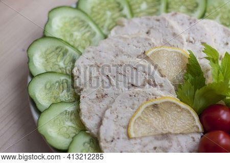 Cut The Meat Of A Baked Chicken Into Slices. Slices Of Baked Chicken Meat Are Laid Out On A Plate Al