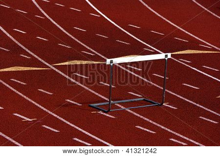 Running track with a hurdle