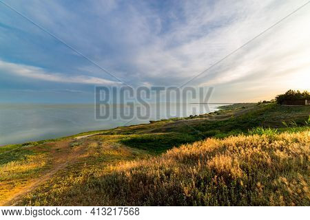Slopes Of Coast Down To The Sea Bay.