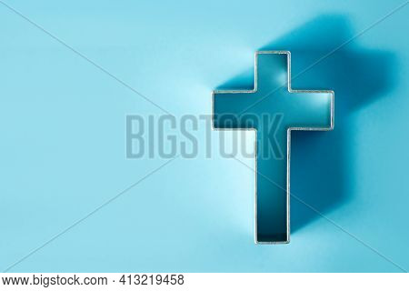 Church Worship, Salvation Concept. Silhouette Of Christian Cross On Blue Background, Soft Bokeh Ligh