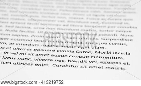 Closeup Of Lorem Ipsum Text On White Paper.