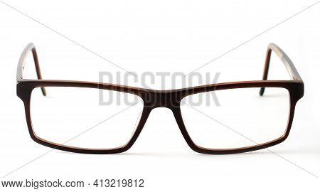 Closeup Of Brown Modern Eyeglasses On White Background.