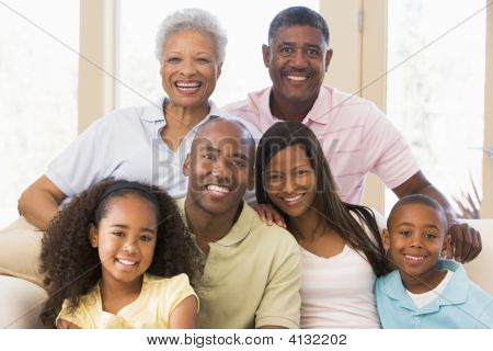 Extended Families Sitting On Sofa