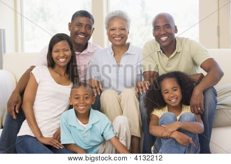Extended Families In Living Room Smiling