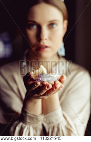 Young European Girl Holding A Gemstone With Boths Hands In Front Of Her. Mystical Woman. Occult, Wit