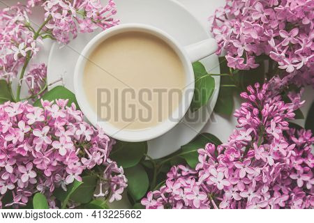 Spring Composition Flat Lay White Cup Of Coffee, Pink Lilac Beautiful Bouquet Of Lilacs, Old Book, C