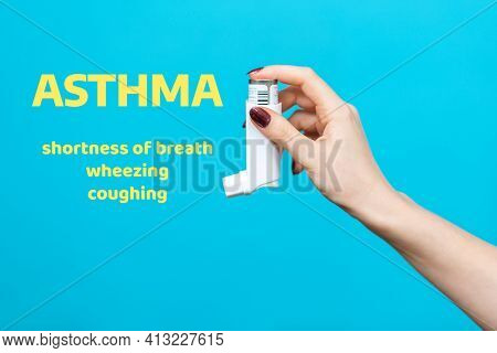Symptoms Of Asthma. A Woman's Hand Holds An Inhaler With Medicine. Side View. Blue Background With T