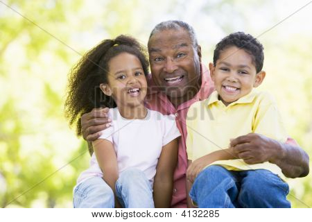 Grandfather Laughing With Grandchildren.